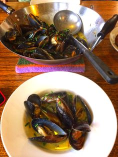 Mussels Bouillon with fresh garden herbs and saffron.
