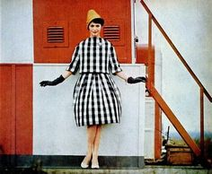 hat!Isabella in black and white check suit with wide-shouldered jacket and pleated skirt by Scaasi, photo by Howell Conant, 1959