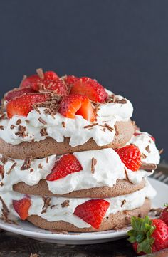 This chocolate pavlova cake is made with chocolate meringue, whipped cream and fresh strawberries. This is the fanciest easy dessert recipe ever!