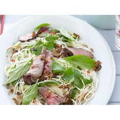 This fresh and fragrant Thai beef salad with chilli and lime gets a powerful kick from its fish sauce based dressing. One of the classic dishes of Thai cuisine and a favourite on restaurant menus the world over. Lime Recipes, Beef Recipes, Salad Recipes, Thai Beef Salad, Grill Plate, Fish Sauce, Menu Restaurant, Cherry Tomatoes, Lunch
