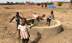 Kids in Mali play around a well. This community is now using our Wood Mold for BioSand Filters! #CleanWaterWednesday