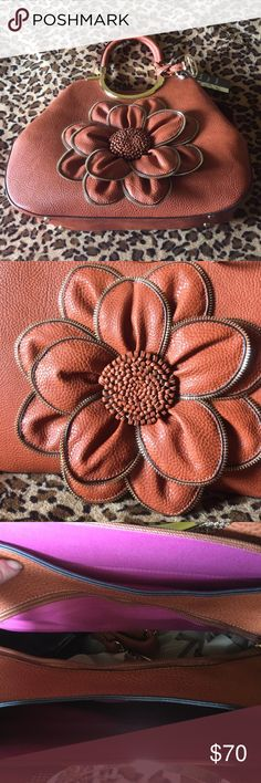 Sorrentino Handbag Sorrentino Handbag with Flower Design. Comes with long strap as well. Brand New with Tags. Sorrentino Bags Satchels