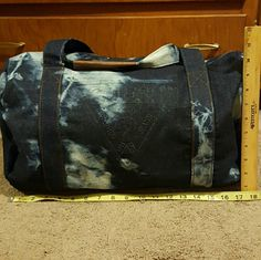 Guess duffle bag denim new New, never used,  no tags Guess Bags Travel Bags