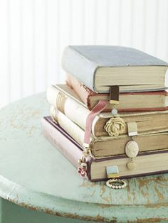 vintage bookmarks and old books... could DIY bookmarks from old jewelry/brooches & ribbon