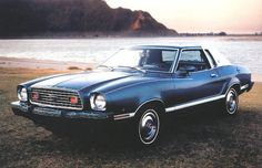 Ford ads and period pictures / 1975 Ford Mustang-II Ghia Sport Coupe picture from the Old Car Manual Project. Photos, brochures, manuals, pictures, diagrams of old and classis cars and automobiles. Mustang Azul, 1979 Ford Mustang, Blue Mustang, Mustang Fastback, Ford Mustangs, Ford Lincoln Mercury, Pony Car, Car Ford, Ford Motor Company