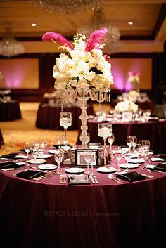 Tall wedding centerpiece with white flowers and roses.