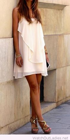 White dress cuts and golden accessories