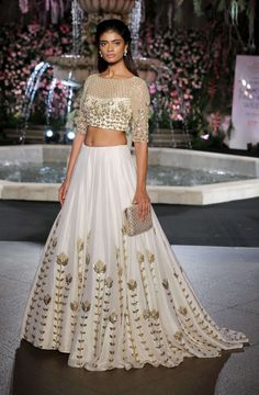 White Colour Banarasi Silk Fabric Party Wear Lehenga Choli Comes With Matching Blouse. This Lehenga Choli Is Crafted With Thread Work,Sequins Work. This Lehenga Choli Comes With Unstitched Blouse Whic. Manish Malhotra Lehenga, Silk Lehenga, Manish Malhotra Bridal, Lengha Saree, Sabyasachi Bride, Lehenga Style, Silk Dupatta, Fashion Week 2016, Lakme Fashion Week