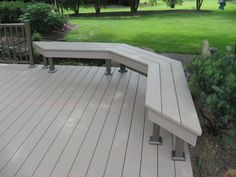 ground level deck with built in bench. composite deck material.