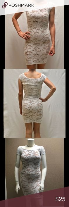 """White dress Seamless bodycon design - openwork stitch design - short sleeves - off shoulder look - partially lined - 92% nylon, 8% spandex - bust - 11 - center back to hem: 28"""" - measurements taken with item laying flat - heavy stretch fabric, may be worn by a small to a large - great quality by the manufacturers of bebe and bcbg but has no name Brand tag - item 47 Dresses Mini"""