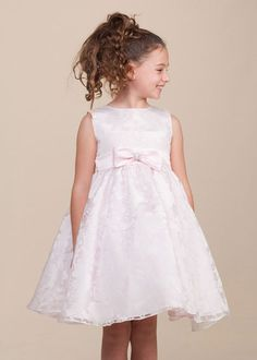 This fabulous organza dress is brimming with sweetness and event ready flair. It is adorned with a lovely floral print on soft organza, tea length styling, a satin sash with an adorable bow and glamor