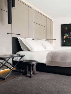 cream wall with black lines + black bed + charcoal carpet | via Handsome Sexy Man Rooms ~ Cityhaüs Design