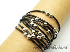 Multilayer bead braid bracelet---antique silver personality beads charms bracelet,black wax cords bracelet. $4.29, via Etsy.