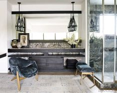 The cabinetry and mirror frame in Courtney Cox's master bath are ebonized white oak.