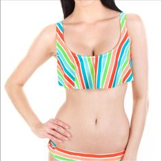 Rainbow striped flutter bikini top Vibrant striped bikini top with bow detail connecting the shoulder straps across the upper back makes this piece cute and flirty. Removable soft cup padding inside the bust. Fastens with metal slide hook.  NWT The Bikini Lab Jackets & Coats