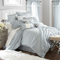 Upagrade your bedroom with this stunning comforter set. The blue/ grey tones and ruffled details make the perfect look.