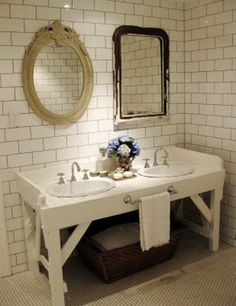 I like these mismatched mirrors, I never thought of doing this. And the sinks are put into an old workbench. By Anna Spiro.