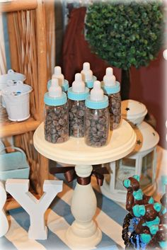 Cute baby bottle favors at a boy baby shower!   See more party ideas at CatchMyParty.com!  #partyideas  #babyshower