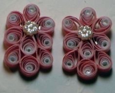 Pretty pink jewelry made with quilling; now add bling and you have a pair of earrings ready to meet the day. The durability and lightweight of quilling jewelry is one of the best points.  After wearing heavy earrings for years your holes get stretched out; in fact the whole ear lobe hangs lower.  But with lighter weight earrings that will not happen.  Go to www.artbybetty.blogspot.com