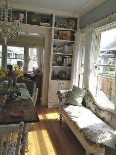 Here's another dinning room filled with bookshelves.  I really like the couch under the window.