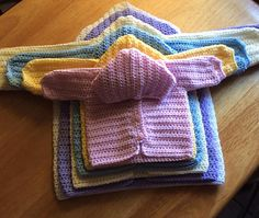 This Free pattern in all sizes HERE: http://hooked-on-crocheting.blogspot.com/2015/02/three-way-baby-sweater.html