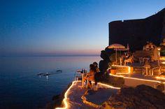 Dubrovnik, Croatia: Bar Buza outside of the city wall at dusk.