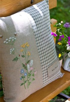 Love this embroidered wildflower pillow