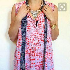 DIANE von FURSTENBERG 100% Silk. Great Condition!  Orange, white and black geometric print top. Front zipper detail & neck tie Diane von Furstenberg Tops Blouses