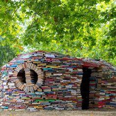 Books of Paper - recycled into a house. Sharkey's future home. I like the way it kinda looks like a Hobbit house.