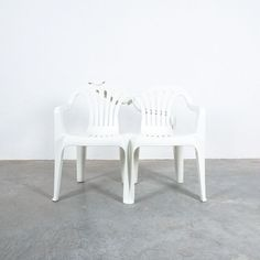 Bert Loeschner Dudes White Plastic Chair Appropriation White Plastic Chairs, Art Gallery, Furniture, Home Decor, Art Museum, Decoration Home, Room Decor, Home Furnishings, Home Interior Design