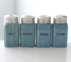 Set of 4 Fired-On Blue Range Shakers.
