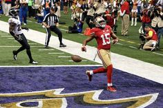 San Francisco 49ers wide receiver Michael Crabtree (15) scores a touchdown against the Baltimore Ravens in the third quarter of Super Bowl XLVII - Feb 3, 2013