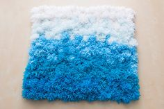 A Pom Pom Rug, Wall Hanging and Table Cover in One! | Brit + Co