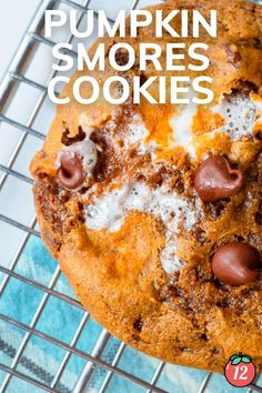 I'm so excited to share this Pumpkin S'More Cookie recipe with you today! These delicious cookies have all of my favorite fall flavors. With pumpkin puree, pumpkin spice, peanut butter, chocolate chunks, and marshmallows, these decadent cookies are sure to be a hit Pumpkin Pie Spice, Pumpkin Puree, 12 Tomatoes Recipes, Smores Cookies, Delicious Cookies, Marshmallows, Cookie Dough, Cookie Recipes, Peanut Butter