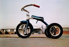 """""""Tricycle in Memphis"""" by William Eggleston. PS: Bookmarked for later reading, """"William Eggleston, Prophet of Contemporary Color Photography."""