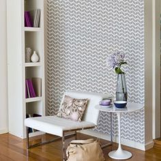 Herringbone wallpaper in light grey and white by Curio and Curio is stunning