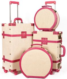 Pretty pink and white luggage from Steamline Luggage's Editor Collection; via allisonleighann
