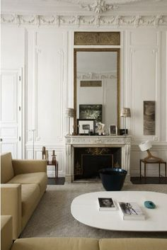 tall mirror above fireplace