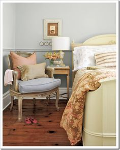 I'm influenced by older architecture- hard wood floors and thick white baseboards.  This bedroom shows a soft color palate that I find relaxing.  Soft yellows, sage and pale blue.