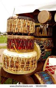 authentic native cultural American war-drums of various designs by JOSEPH S.L. TAN MATT, via Shutterstock