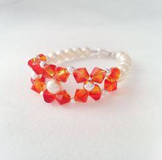 Mi Amore Jewels - Fireopal Swarovski Crystal with Cream Pearl Bracelet, $24.99 (http://www.miamorejewel.com/fireopal-swarovski-crystal-with-cream-pearl-bracelet/)