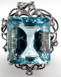 Vintage Aquamarine Pendant w/ 51 Carat Emerald Cut in 14K White Gold 1940's. This magnificent vintage aquamarine pendant features a massive 51 carat emerald cut center stone and genuine diamonds accents. This 1940's pendant is crafted of solid 14k white gold and is in good condition. Via Era Gem.