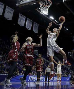 Stanford's Alanna Smith (11) gets past New Mexico State's Brooke Salas (2) to put up a shot during the second half of a first-round game in the NCAA women's college basketball tournament Saturday, March 18, 2017, in Manhattan, Kan. Stanford won 72-64. (AP Photo/Charlie Riedel) Photo: Charlie Riedel, Associated Press