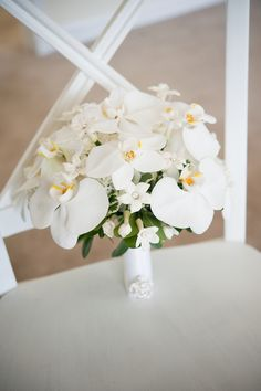 White Orchid Bouquet but mine will have blue in it also.