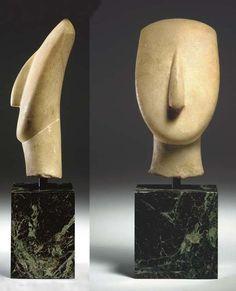 A CYCLADIC MARBLE HEAD LATE SPEDOS VARIETY, CIRCA 2500-2400 B.C.