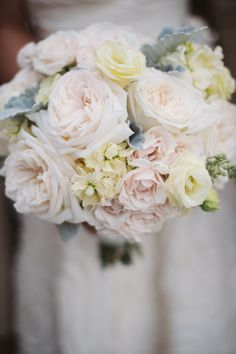 Blush, grey and ivory bridal bouquet with garden roses and dusty miller  Flowers by Pollen.  www.pollenfloraldesign.com.  Photo by Two Birds Photography.  www.twobirdsphoto.com
