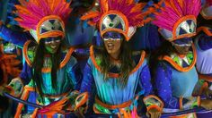 Revellers of Portela samba school dance at carnivale festival.