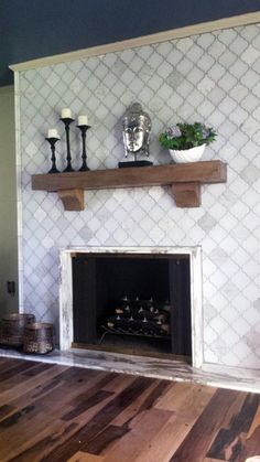 Moroccan arabesque style is that new modern trend in mosaic tiles that is lighting up the interior design scene. The Clover Arabesque Blanco glass tile is an excellent option! Mosaic Fireplace, Fireplace Tile Surround, Home Fireplace, Fireplace Remodel, Living Room With Fireplace, Fireplace Surrounds, Fireplace Design, Fireplace Mantels, Fireplace Ideas