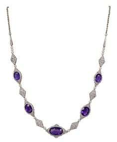 Pearl Amethyst Diamond Antique Necklace. Antique necklace set with 5 oval faceted amethysts surrounded by diamonds. Each link is separated with a pearl. The amethysts and pearl are separated by diamond shaped filigree links set with small diamonds. The total carat weight of the amethysts is acts. c 1890