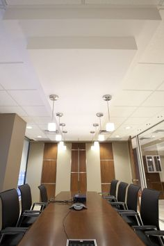 An gorgeous boardroom wall that opens up to a projector-screen
